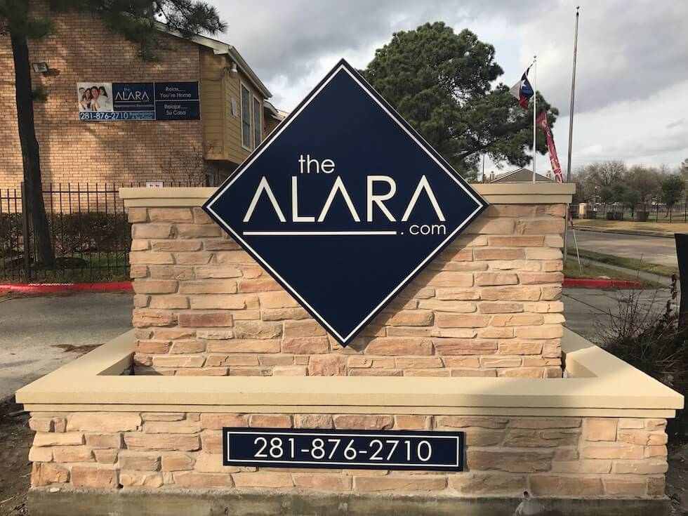The Alara diamond shaped sign with square stone base.