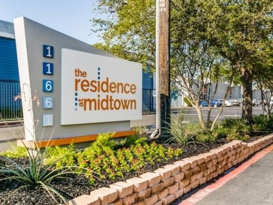 Residence at Midtown sign in raised, stone bordered flowerbed.